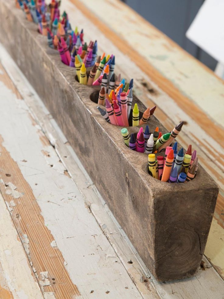 On the craft table, Joanna repurposed a rustic candle holder as a centerpiece that makes a visual statement while serving as the perfect receptacle for a colorful array of crayons.