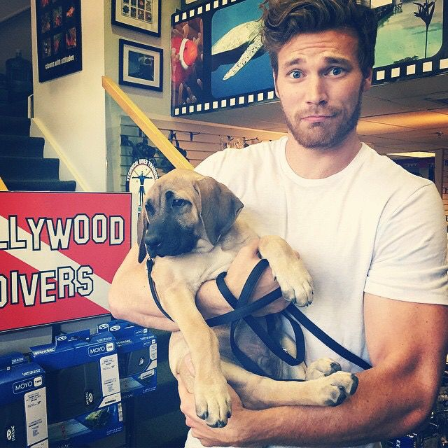 Derek Theler. A cute guy and a puppy...I'm powerless
