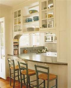 open shelves over top of arched pass through windows
