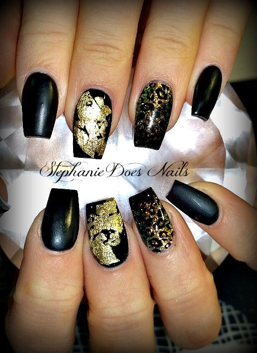 Gold foil on black acrylic nails