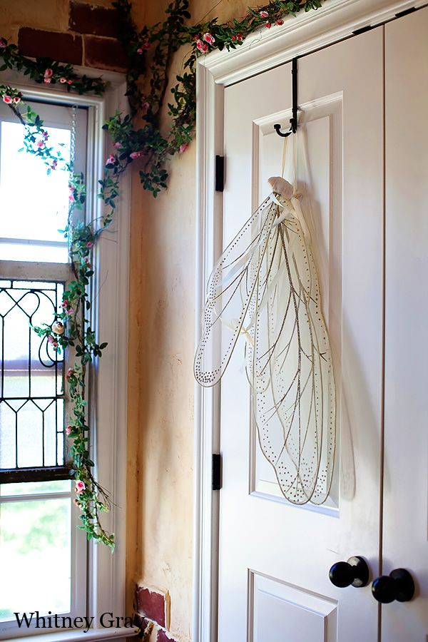 "Lots of pictures of a really sweet ""secret garden"" themed room. Love the fairy/angel wings hanging on the outside of the closet door. Could be hung from a branch peg on the wall."