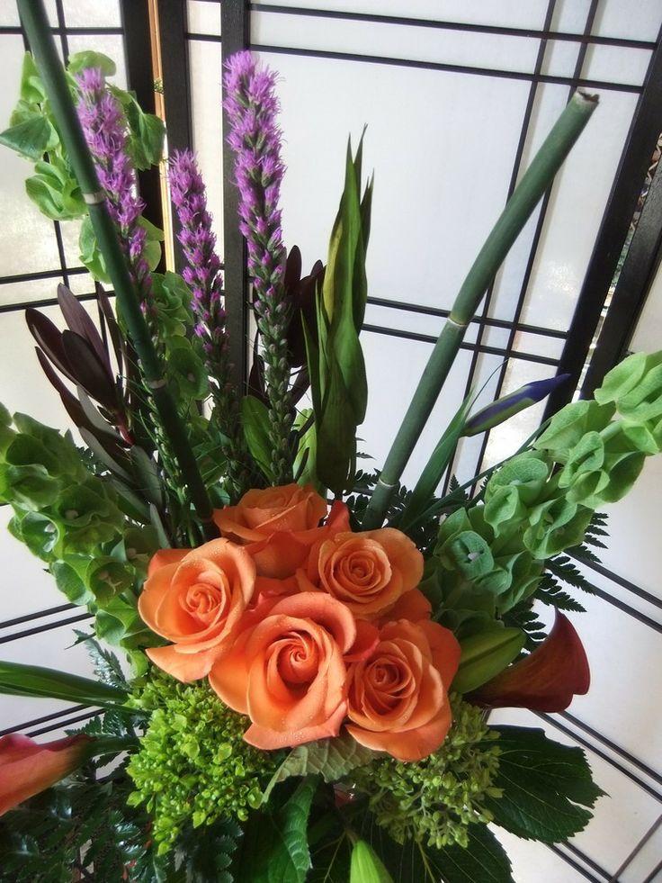 Dutch Garden, vase, liatrus, bells, leucadendron, iris, orange roses, green hydrangeas, callas, lillies, equisetum & leather