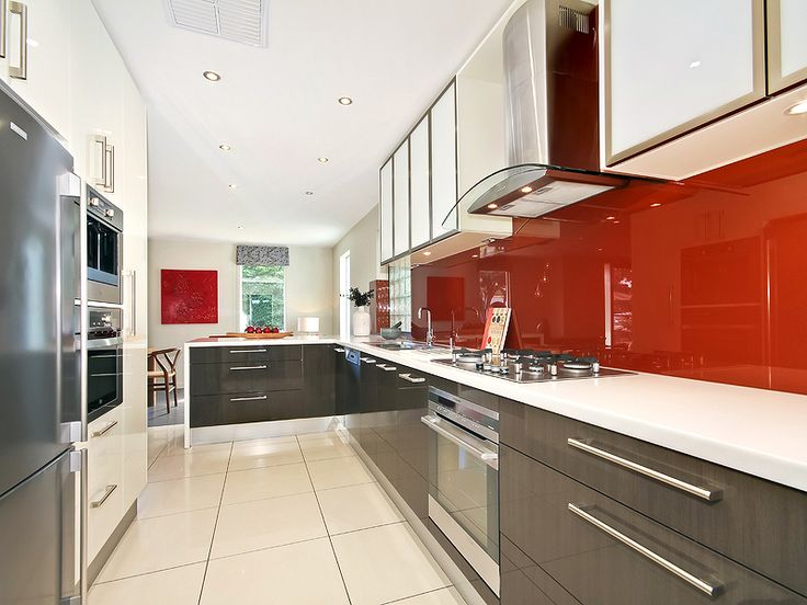 #Modern #Home in O'Sullivan Beach. Professionals Christies Beach real estate agency. 08 8382 3773. #Kitchen #Red #SplashBack