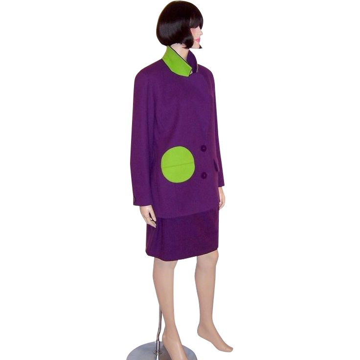 This is a snappy, classic, and wearable suit designed by Arabella Pollen, trimmed with witty and unexpected touches of chartreuse at the right pocket