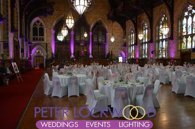 a view of the stage and organ with wedding lighting at rochdale town hall