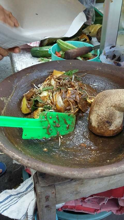 """Rujak Cingur Traditional Food Indonesia,  vegetables salad with spicy sauce. Literally """"cingur"""" means mouth in Javanese. This food has become the unique taste of Surabaya. The flavour is really unique, because it combines of slices of cooked buffalo or beef lips, yam bean (bengkuang), young raw mango, pineapple, cucumber, bean sprout, kangkung ( water convolvulus), lontong (compressed rice), fried tofu and tempe, all served with  black sauce made from fried garlic, chillies, a slice of young…"""