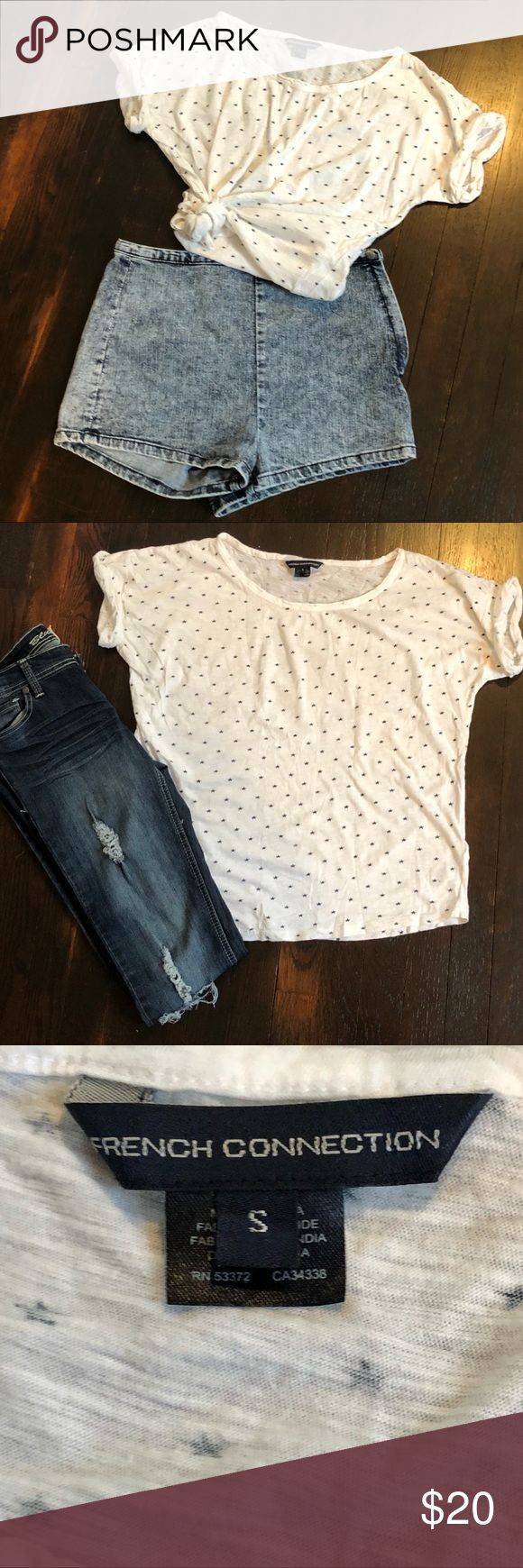 ⭐️French Connection star tshirt ⭐️French Connection star T-shirt (S)  ⭐️Scoop neck, folded cap sleeves, over size fit ⭐️white shirt with tiny navy blue star pattern ⭐️Can be worn multiple ways- tied up as a crop top, or loose and comfy with jeans! Pair with a matching denim jacket for a put together look! ⭐️Perfect for the 4th of July! ⭐️Open to offers! French Connection Tops Tees - Short Sleeve