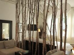 Birch branches room divider.  I love this because you don't loose the view yet you divide!