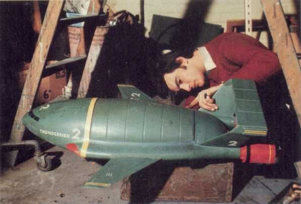 Ian Scoones touches up Thunderbird 2 between takes