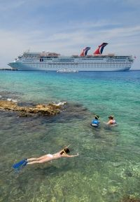 With plenty of diversions, a cruise can be ideal for a large family gathering; here, Carnival Cruise Lines moors in Cozumel, Mexico.