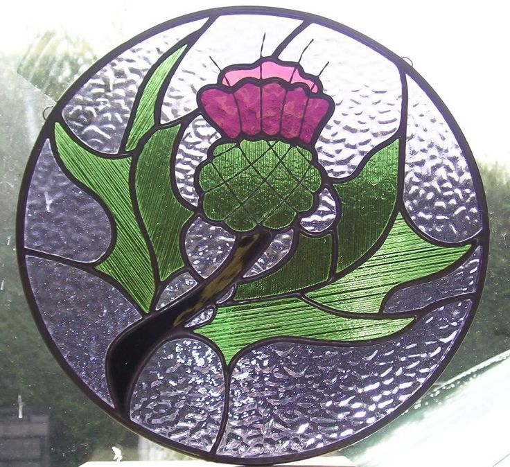 Beautiful detail....  (Scottish Thistle stained glass.  I would love to have this for my kitchen window!!!)