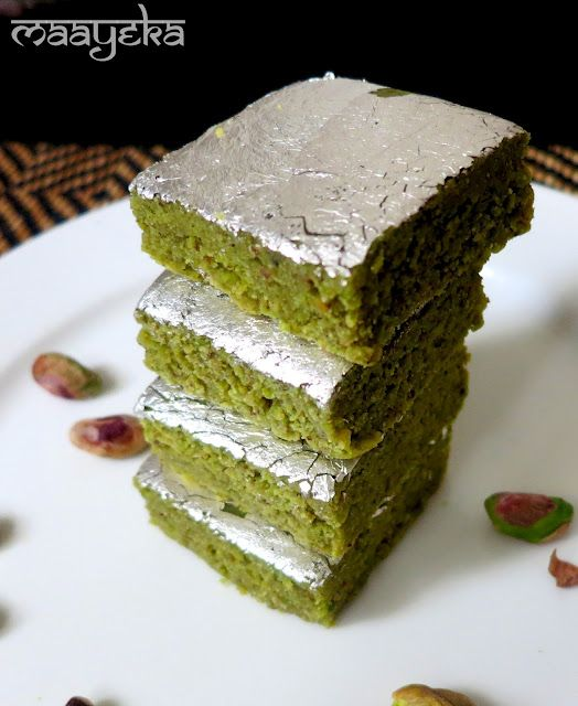 A delicious,quick and easy pistachio fudge/burfi   Pistachios - 1.5 cups Sugar - 3/4 cup Water - 3/4 cup Ghee-1 tsp Full fat Milk powder - 3 tbsp* Cardamom powder - 1/2 tsp Silver foil (Varak) - 3*