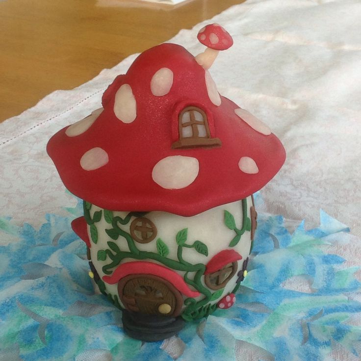 My daughter made this beautiful fairy house candle holder jar out of a recycled jar and Skulpy Clay.