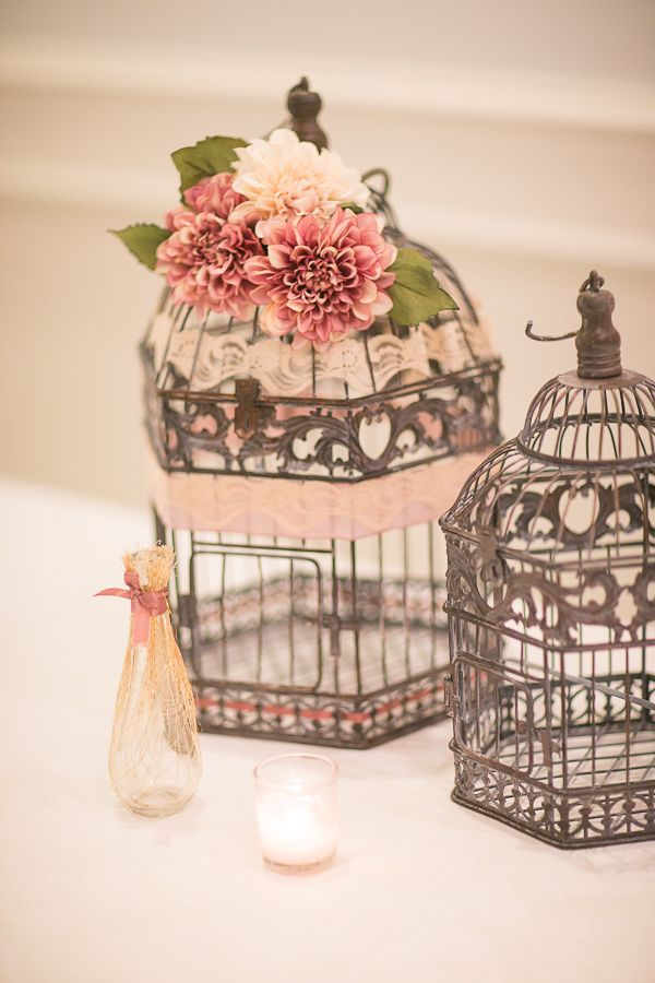 vintage birdcages // photo by Sandy Tam // http://ruffledblog.com/ontario-vintage-handmade-wedding