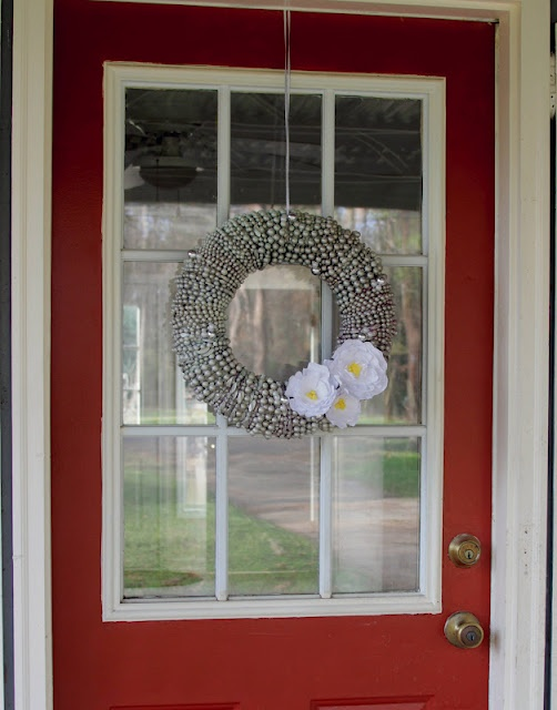 cute wreath made with recycled Mardi Gras beads
