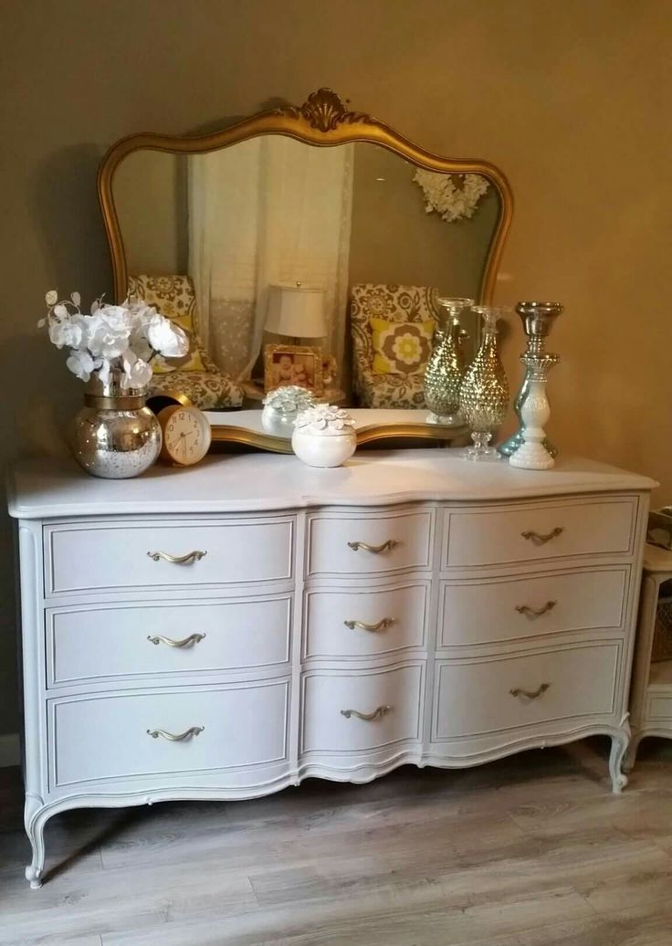 Upcycled, repurposed and refinished this Dixie dresser and mirror. I did a soft gray chalk paint, Rustoleums gold spray on the knobs and mirror. The. Finished it with the clear wax. Simple yet elegant. You can see more of my pieces on my FB page ChicandShabbyFurnitureByRebecca