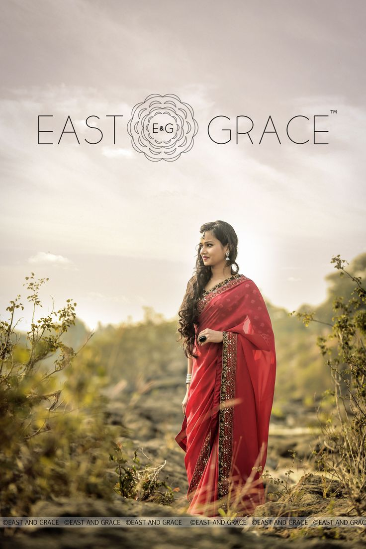 PRICE: INR 11,987.00; US$ 181.62 To buy click here: https://www.eastandgrace.com/products/red-ruby Featuring the Red Ruby saree in pure flat silk-chiffon with antique golden sequin embellished border, that folds the past into the present effortlessly and elegantly. The unusually complementary navy synthetic raw silk blouse, with graceful, white motif embroidery adds that extra special quirk and elevates your style to a new high. For help reach us at care@eastandgrace.com.