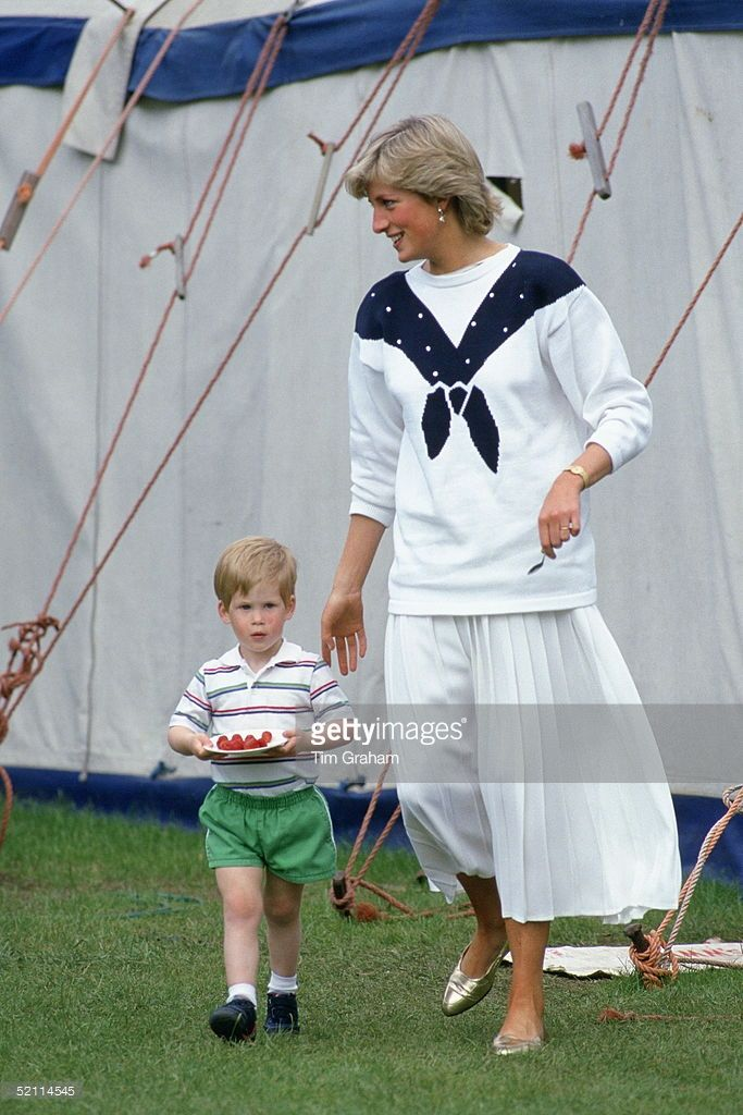 Diana, Princess Of Wales With Prince Harry Carrying A Plate Of Strawberries. She Is Wearing A Jumper By Fashion Designerroland Klein And A White Pleated Skirt By Jasper Conran.