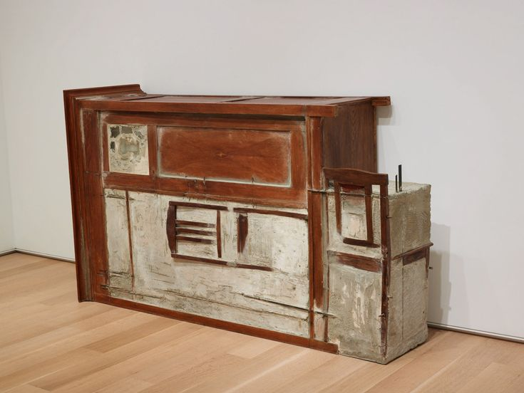 Doris Salcedo  Untitled (Armoire), 1992  Wood furniture, steel, and cement 45 x 73 1/2 x 20 in. (114.3 x 186.7 x 50.8 cm)  Untitled (Armoire) is part of a series in which Salcedo buried domestic furniture and other personal objects in cement, stripping these utilitarian pieces of their functions and turning them into humble monuments to their lost, silenced, or forgotten owners.