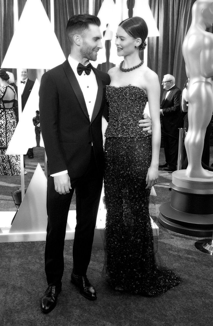 Pin for Later: Stunning Oscars Pictures You Haven't Seen Yet Adam Levine and Behati Prinsloo