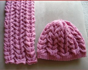 Knitting pattern for an 8ply cable scarf and matching beanie.