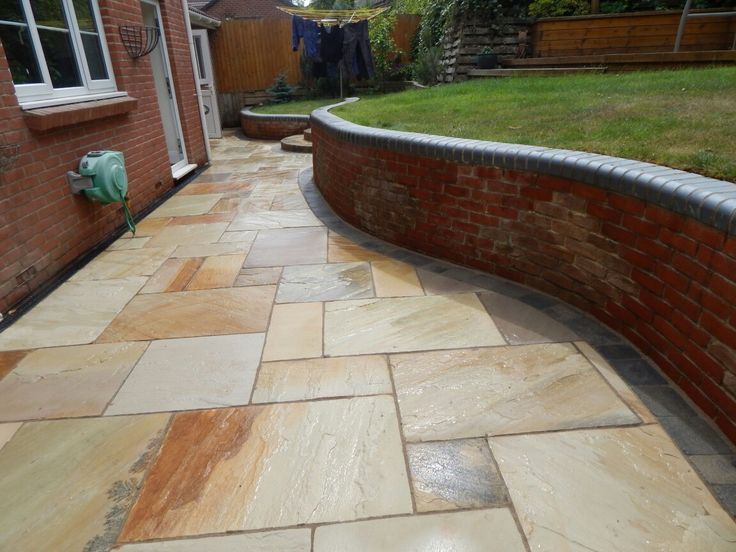 Indian Sandstone Golden Fossil paving brings out all of the warmest natural tones and gives a welcoming feel. Full maintenance available.