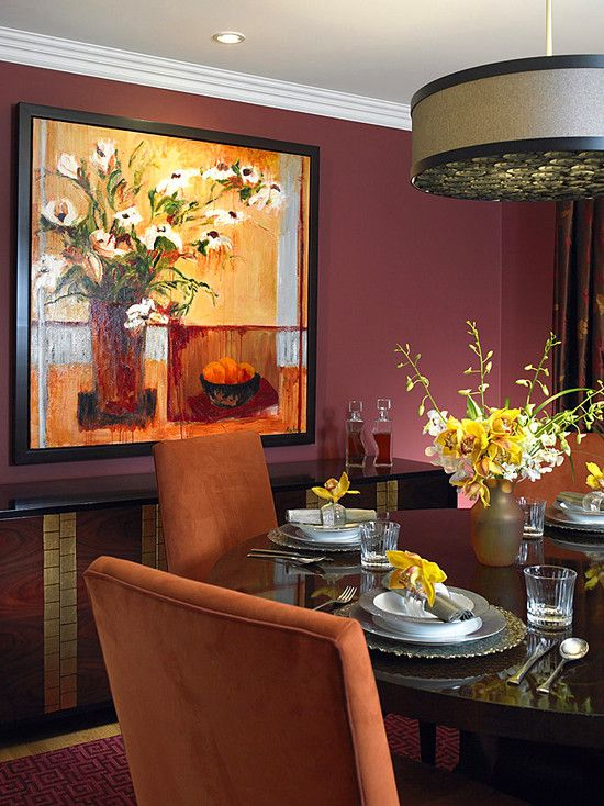 A Marsala dining room, gorgeously accented with yellows, grays, and deep mahogany furniture.