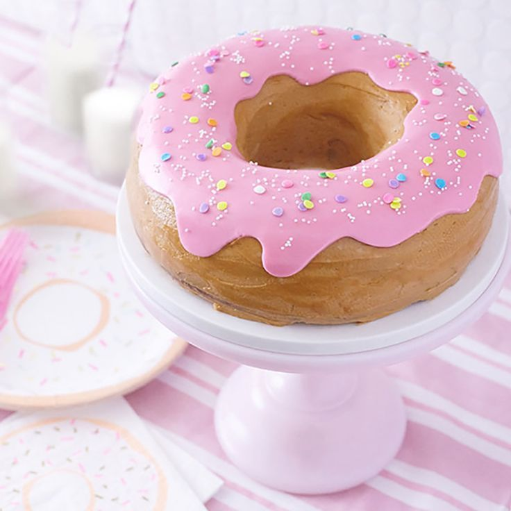 Giant Donut Cake! Learn how to make this adorable, sprinkle-coated, giant donut cake with a simple step-by-step tutorial.