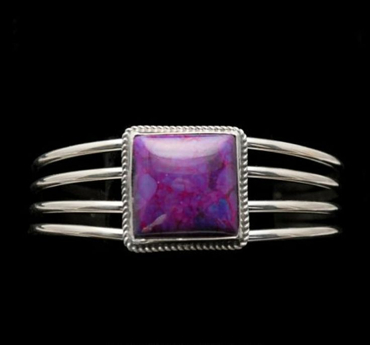 Square Magenta Turquoise Sterling Silver Cab Bracelet Square Magenta Turquoise cabochon on 4 bands of Sterling http://nativeamericanstuff.net/magenta_turquoise_jewelry.htm