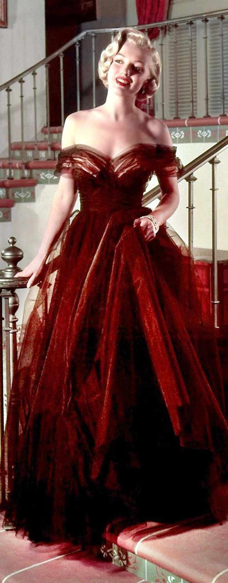 Red dress 1946 symbolism gold