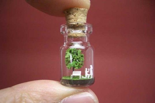 Izumi Akinobu's paper art Tiny World in a Bottle    This would make an awesome present if your made it into a keyring. You could use miniature plastic trees from any art shop, paper shapes, super glue and a tiny glass corked bottle.