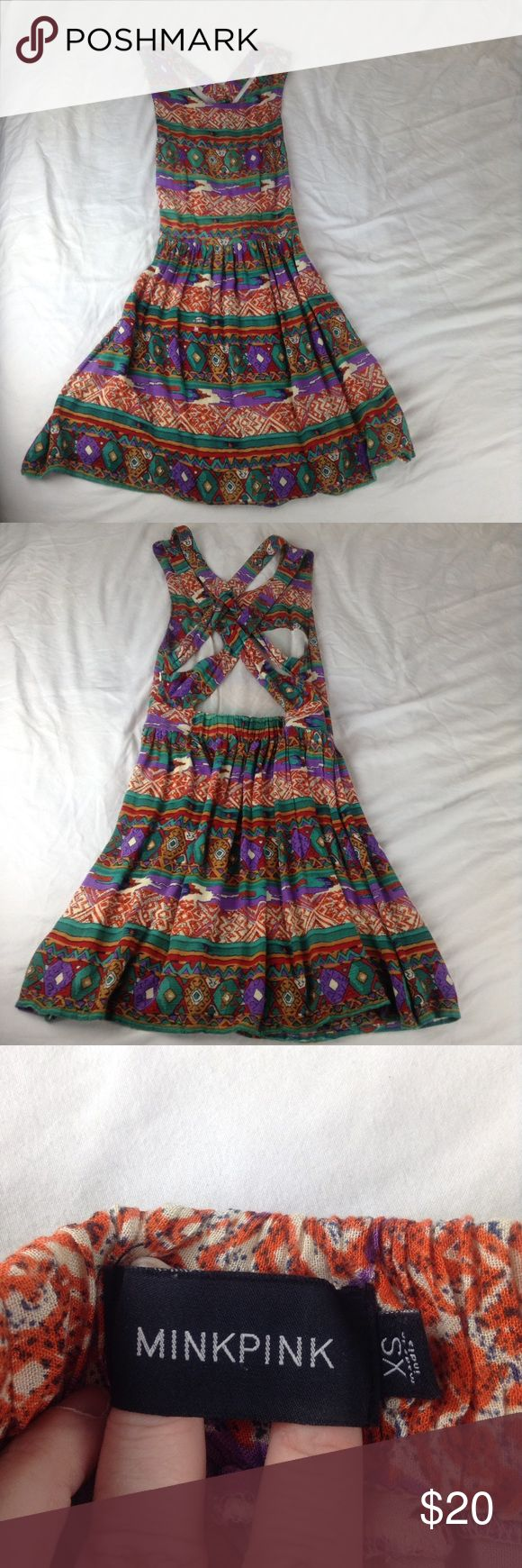 """Minkpink Woodstock Aztec Boho Cross Back Dress This is a Minkpink Dress  STYLE: Strap Back  COLOR: Multi-Colored  SIZE: Women's XS  CONDITION: Preowned/used - Excellent condition with no stains or damage  MEASUREMENTS: 16"""" armpit to armpit, 14.5"""" seam to seam at the waist, and 37.5"""" in length from shoulder seam to hem.   All clothing from my closet comes from a pet free and smoke free home.   SHIPPING TIME: I ship all items within 1 business day. (Except on holidays and weekends) MINKPINK…"""