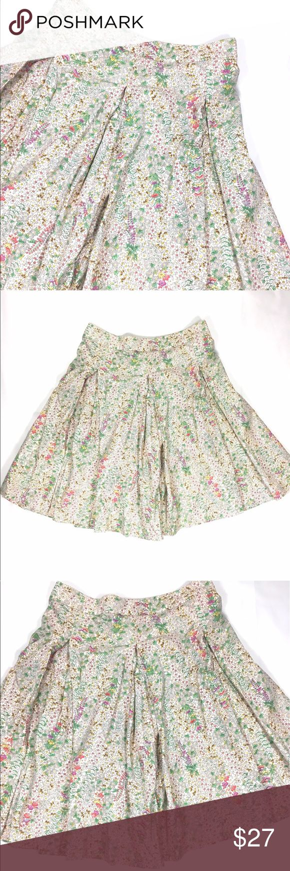 [French Connection] Floral Skirt Size 4 Creme background with purple, pink, yellow, white flowers and green leaves Flowy Zipper on Back 100% Cotton Approx Measurements: Top Hem to Bottom Hem 21in and Waist 14.5 French Connection Skirts Midi