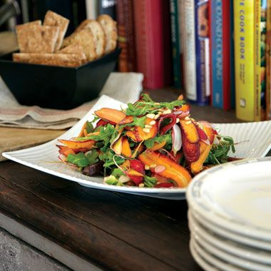 Roasted and Raw Carrot Salad with Avacado and Toasted Cumin Vinaigrette-I love using baby carrots in assorted colors. Thumbelina carrots, which are little and stubby, are great for roasting. I use red, orange, yellow, and white carrots for the ribbons, which make this salad so vibrant.