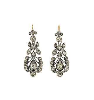A pair of early 19th century diamond earrings  Each old-cut diamond surmount suspending an articulated pear-shaped drop set with old-cut diamonds in pinched collet settings