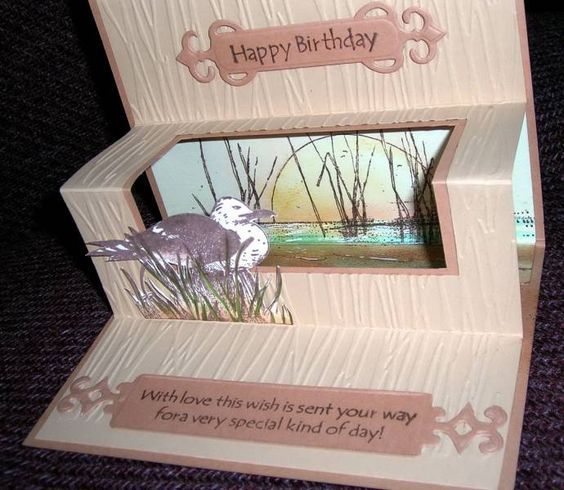 Tunnel Nautical Scene inside by !aah - Cards and Paper Crafts at Splitcoaststampers.  There's a tutorial in the resources section of that site too.