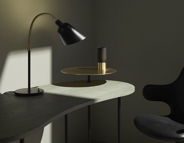 Bellevue AJ8 Table Lamp designed by Arne Jacobsen, is a sleek and minimalistic light that is a strong representation of Danish Modernism. Learn more about this table lamp at LightForm.ca