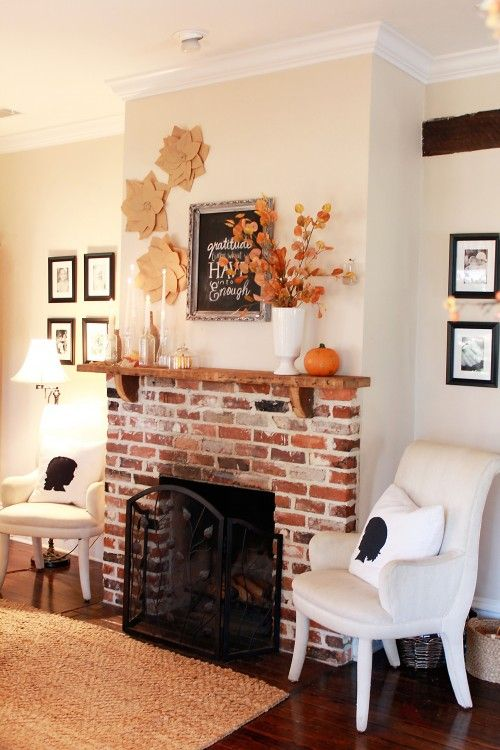 Love this exposed brick fireplace