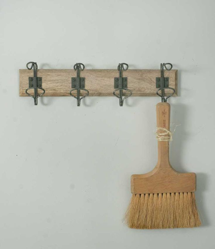 """Four great vintage style hooks mounted on a wood back measuring 14"""" long, 4"""" deep and 2½"""" tall."""