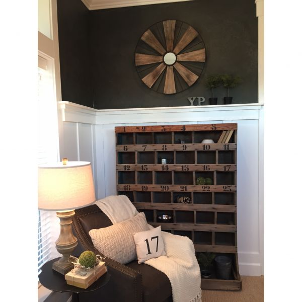 Vintage numbered cubbies lend a rustic touch to this dramatic home office eclecticallyvintage.com
