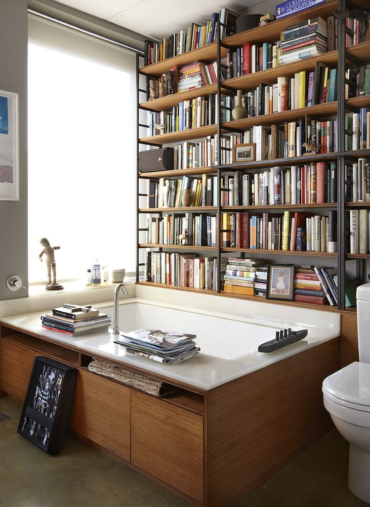 "My Library: Michael Cunningham, author and professor. ""Cunningham generously allowed us to shoot in his New York apartment, which I noted had a beautiful library set into his bathroom walls.""  Me: I adore this in theory, I can't imagine it in practice at my house!  Click through for several more photos, by Joshua Simpson, of this incredible bathroom/library."