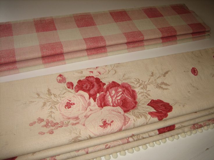 Roman blinds in Kate Forman's Pink Check and Red Roses fabrics.