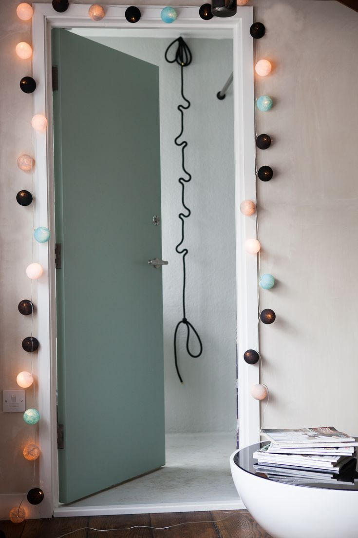 Cable and Cotton lights around a doorway