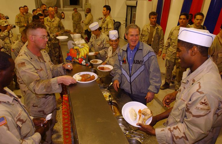 President George W. Bush meets with troops and serves Thanksgiving Dinner at the Bob Hope Dining Facility, Baghdad International Airport, Iraq,