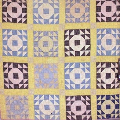"#TextileTuesday Victoria Barnhardt of Rowan County made this ""Wedding Ring"" pattern #quilt in 1927 using sewing scraps of plain, plaid, and printed fabric. The piece features sixteen hand-pieced blocks separated by single yellow sashing and tan corner blocks. Barnhardt hand-quilted the piece in a fan design."