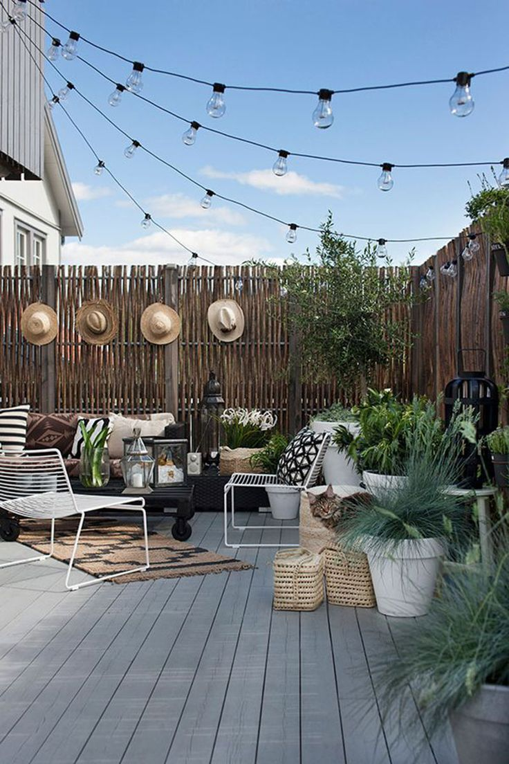 The perect outdoor spot, decorated with string lights on neutral patio
