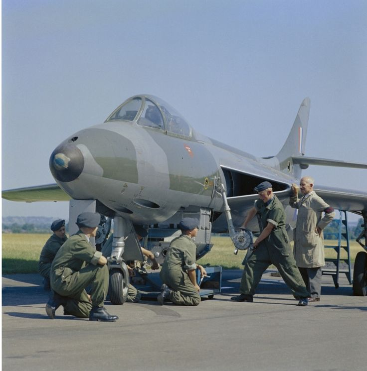 "An instructor shows Aircraft Apprentices of No 1 School of Technical Training at RAF Halton, Buckinghamshire how to load a gun pack of four Aden 30mm cannon into an instructional airframe of a Hawker 'Hunter'. 1961. Electrical Apprentices  learned weapon systems as well as the other aircraft electrical systems. Bomb fusing and release systems, ""Rocket Ripple"" Photo flood, canopy detonators, fuel tank suppression etc. - and the Aden Gun which was cocked and fired electrically."