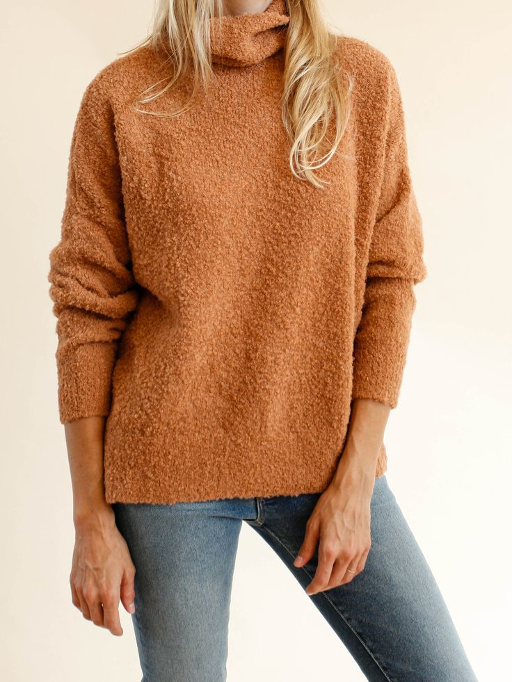 Super yummy, nubby looped knit alpaca in a beautiful clay color. Loose turtleneck, narrow sleeves and cropped fit. Ribbed bottom hem and slits on each side. Color- Sand 100% Alpaca. Made in Peru. Worn