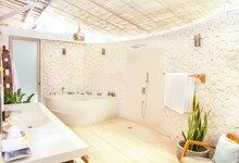 Mana Sari - Vill  in Ubud, Traditional modern bali architecture, using stone and joglo wooden houses.  Our large natural stone bathroom with custom made terrazzo bathtub.