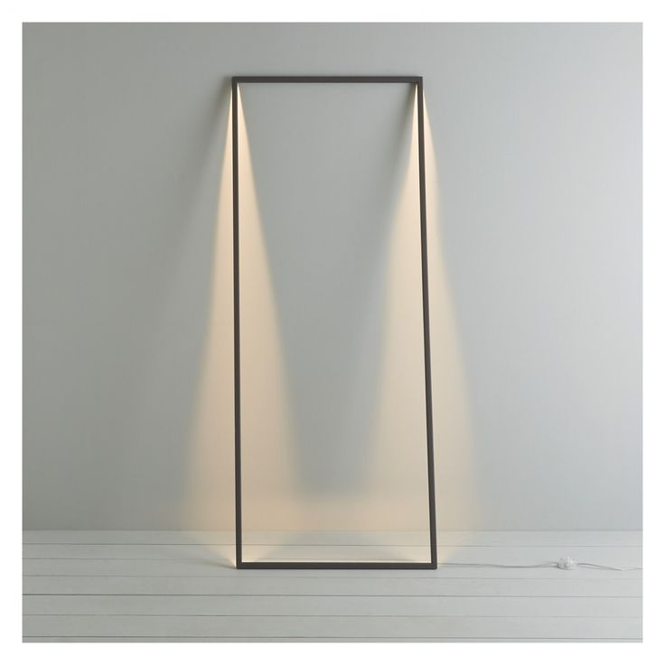 This is a great lamp.    SHADOW  Dark Grey Metal LED Floor Lamp  Colour: Grey    The Shadow dark grey metal LED floor lamp has undisputed 'wow' factor – lean it against a wall and it creates a frame-shaped shadow of light.    £175.00
